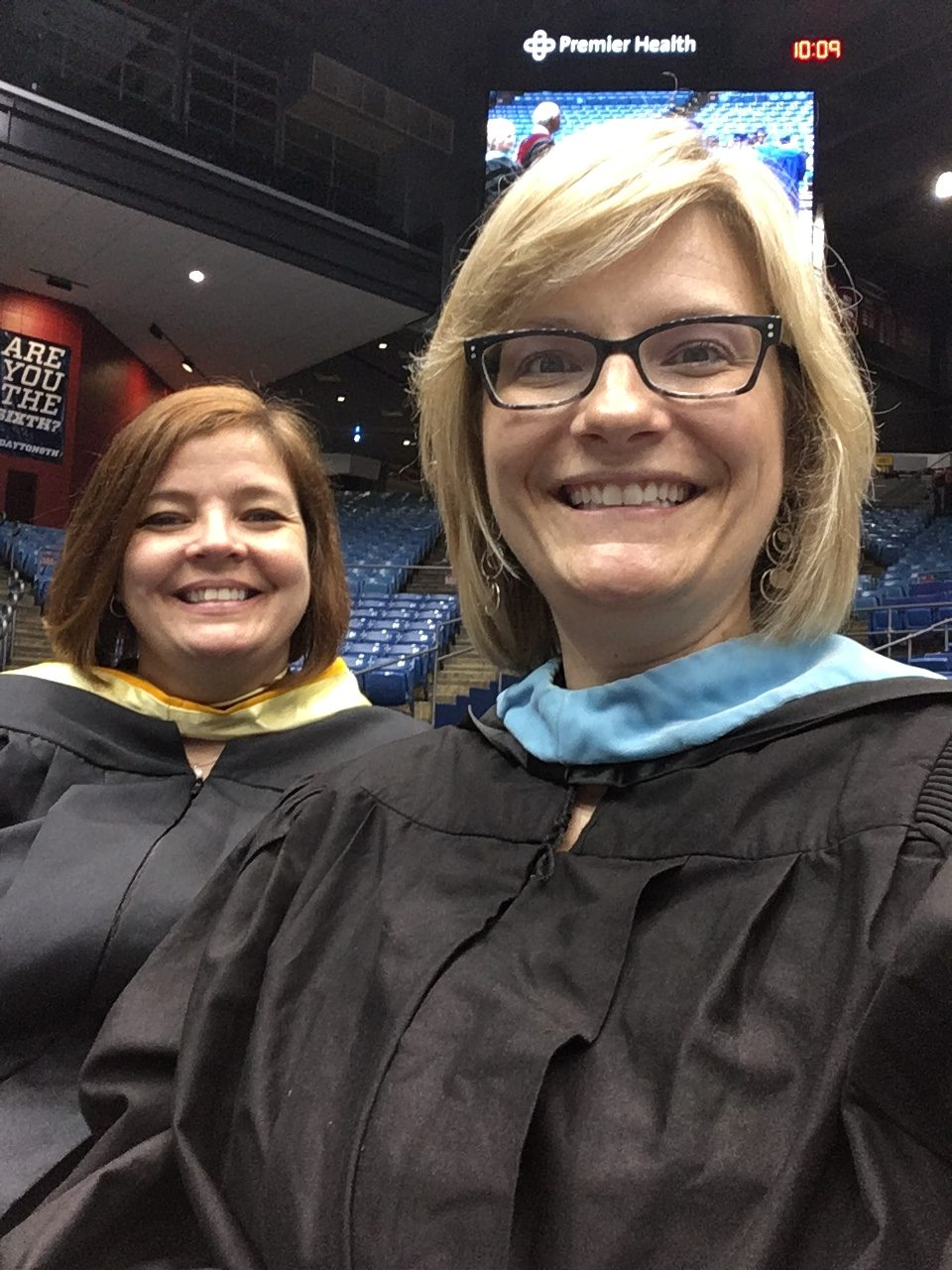 Amy Cox with fellow teacher at Dunbar High School graduation