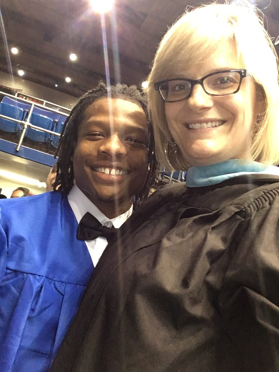 Amy Cox with student at Dunbar High School graduation