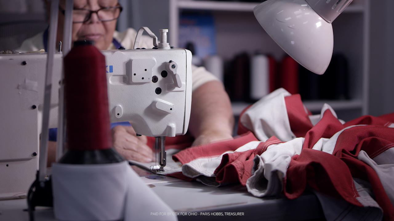 Worker Sewing American Flag